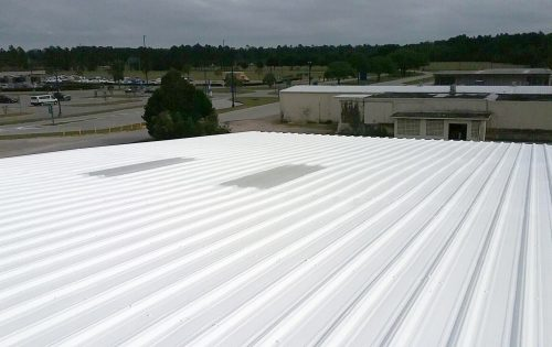 White Metal Commercial Roof and Parking Lot