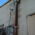 Drainage Components-Rusted Downspouts on Flat Commercial Roof