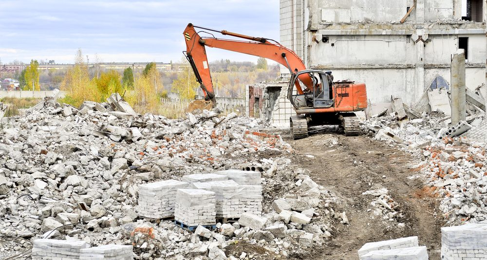 Demolition and dismantling of the remnants of the large industrial facility.