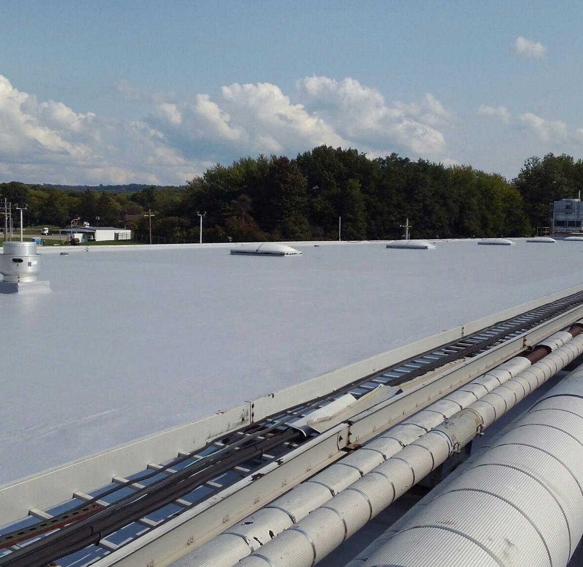 Roof restoration by Simon Roofing on complicated industrial rooftop