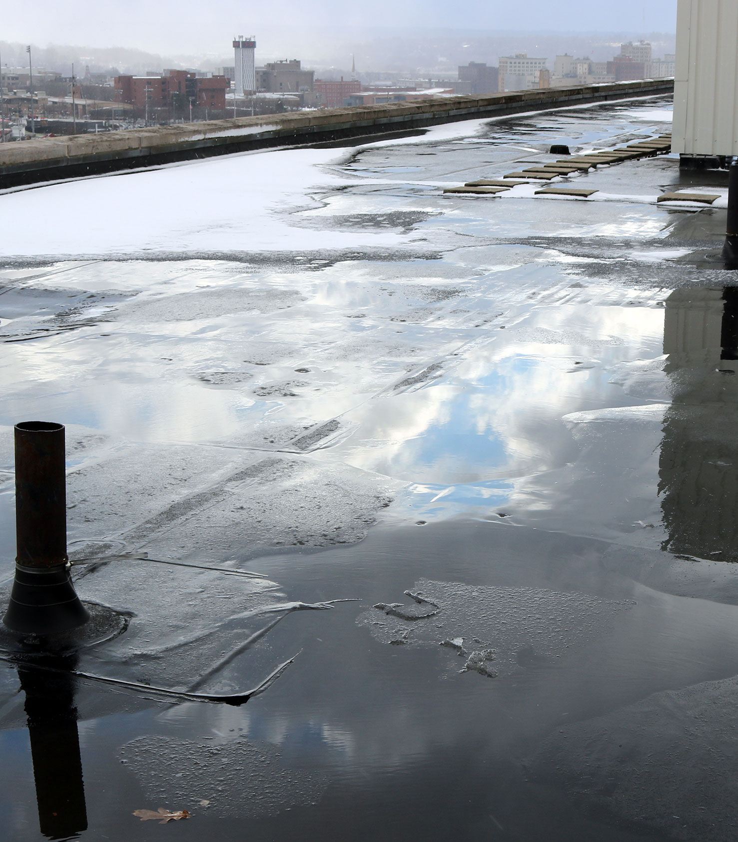 ponding water on commercial rooftop