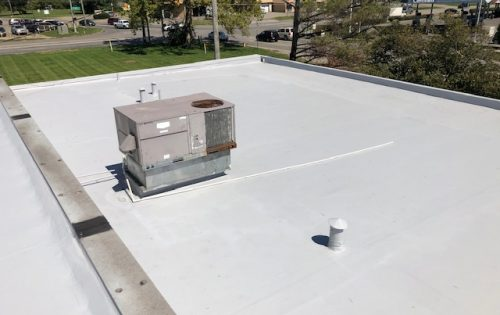 Flat white roof section with HVAC Columbus